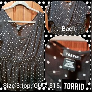 Torrid, size 3, polka top cut out top.
